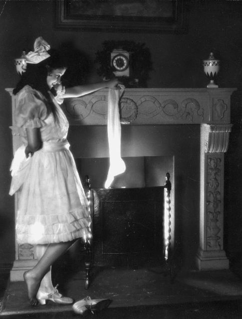 Silent star Marceline Day hangs her stocking for Santa, 1920's.