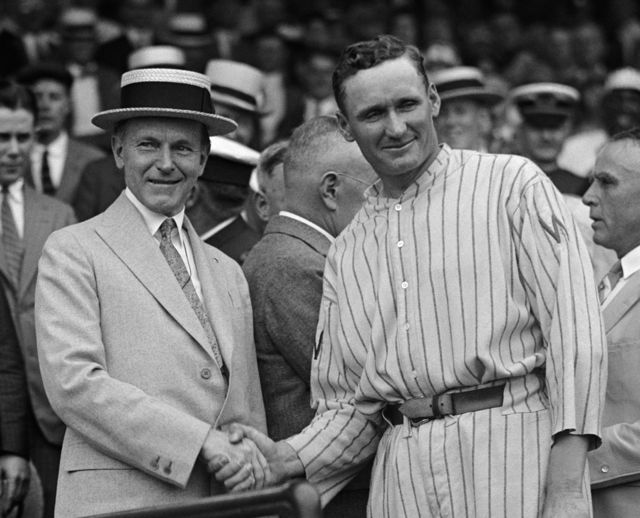 "Calvin Coolidge shakes hands with Walter ""The Big Train"" Johnson, 1924."