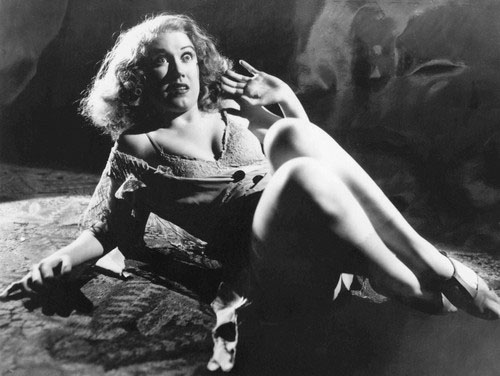 Fay Wray cringes before King Kong, the tallest, darkest leading man in Hollywood.