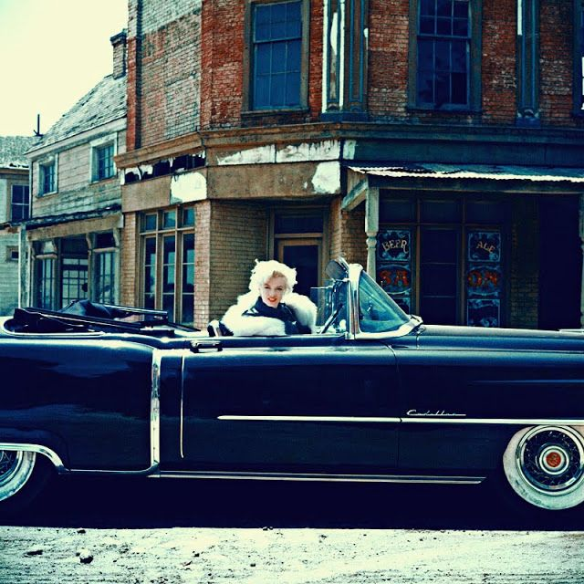 Marilyn Monroe in her Cadillac, 1954. 