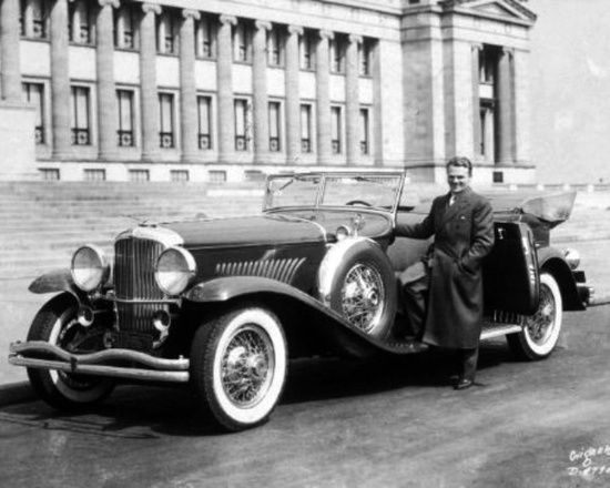 "Jimmy Cagney is justly proud of his Duesenberg. According to Timothy P. McGrane, Executive Director of Blackhawk Automotive Museum, ""This car is one of the two Duesenberg Model J Convertible Sedans by Dietrich from 1931. It is understood that there is only one remaining as the other was destroyed by fire   Cagney was also associated with a 30's V12 Auburn Convertible Coupe."" Thanks to Seraphic Secret reader Bill Brandt for putting us in touch with Mr. McGrane."