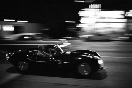 There was a reason they called Steve McQueen the King of Cool. Here he is, racing along Sunset Strip in his Jaguar XKSS,1960s.