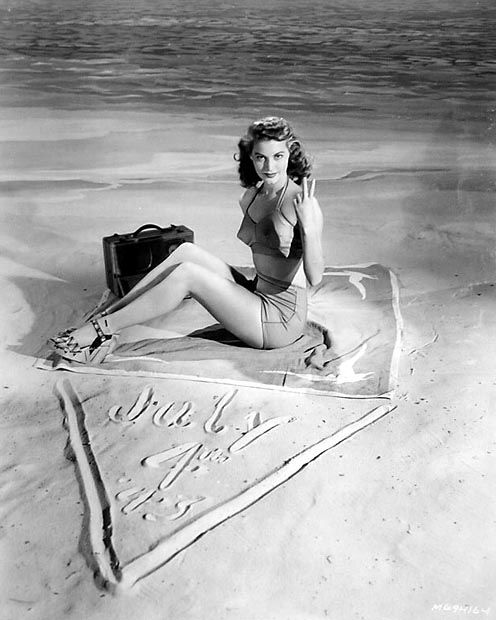Ava Gardner draws a line in the sand for July 4th.