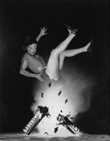 Before she was a star, Joan Crawford, (1904-1977) born Lucille Fay LeSueur, was an ambitious starlet at MGM clawing her way to the top. Unlike most actors, Crawford enjoyed the long sessions with still photographers. Here, in a rather elaborate photo from the early 30's, young Joan appears to ignite July 4 fireworks with, um, star power.