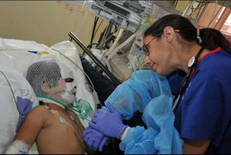 A wounded Syrian child receives treament in an Israeli ICU.