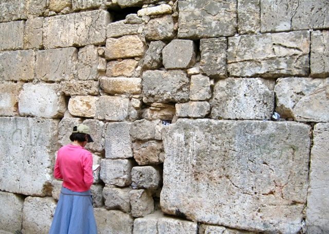 Karen prays at the Little Kotel in Jerusalem.