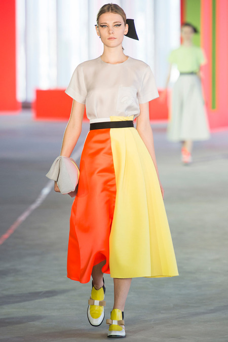 Eye catching color blocking from Roksanda Ilincic. The neutral blouse balances the orange and yellow skirt.