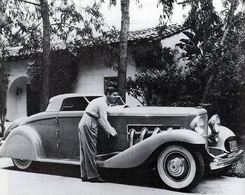 Clark Gable and his customized Dussenberg, 1930s.