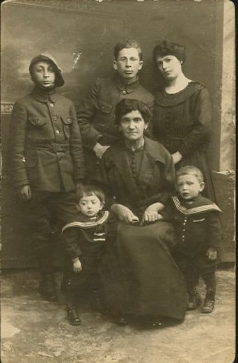 My father was born in Yanuv, a small town in Poland, June 4, 1919. He is the child on the left. His grandmother holds his hand. His older brother Chaim is to the right. Chaim passed away many years ago, but he was also in the Army and served in the Pacific. My grandmother, Miriam, is the lovely woman on the right.