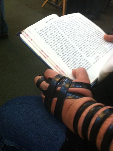 A friend who sits next to me in synagogue is a Persian Jew and as you can see, he wraps his tefillin in the Sephardic tradition.