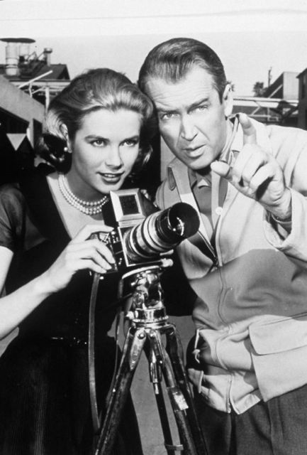 "Grace Kelly and Jimmy Stewart in publicity still for Alfred Hitchcock's masterpiece, ""Rear Window."""