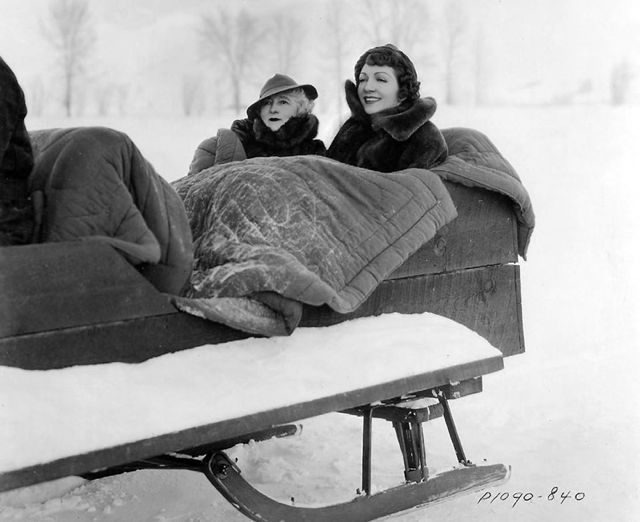Claudia Colbert enjoying a sleigh ride with mother Jeanne.