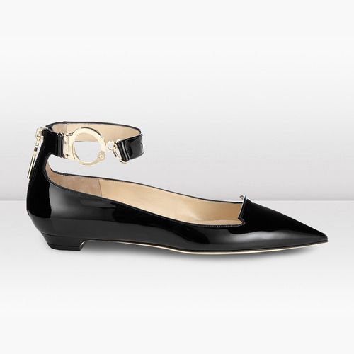Pointed toe ankle strap flat by Jimmy Choo appear both lethal and innocent.