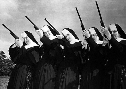 1957, Kingston, Massachusetts, USA: Sisters of Divine Providence set their sights as they try out new .22 caliber guns presented to them at camp Mishannock by Harrington and Richardson of Worcester, Massacusetts. The guns will be used in a rifle training program at the camp. Pictured (R to L) are: Sister Noel, camp director; Sister Rosaria; Sister Wilfrid; Sister Mary Janet and Sister Mary.  Three of the nuns will be instructors in the rifle program.