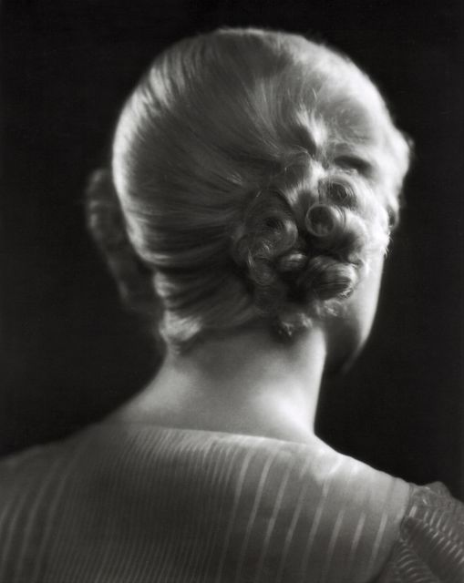 Here's an unusual glamor photo of Alice Faye. The focus of our attention is diverted away from her face to the intricate braiding of her hair.
