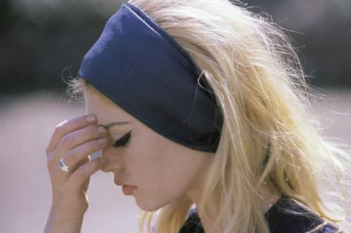 Brigitte Bardot is either thinking deep thoughts or having a migraine.