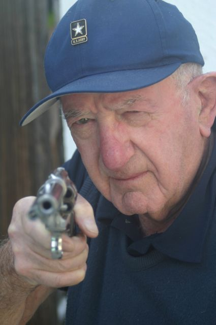 A few years ago, My father was visiting us in Los Angeles. One afternoon, I was sitting in my office, cleaning my guns. My father asked if he could pose with one of my pistols. He chose my Ruger Birdshead, a classic cowboy revolver.