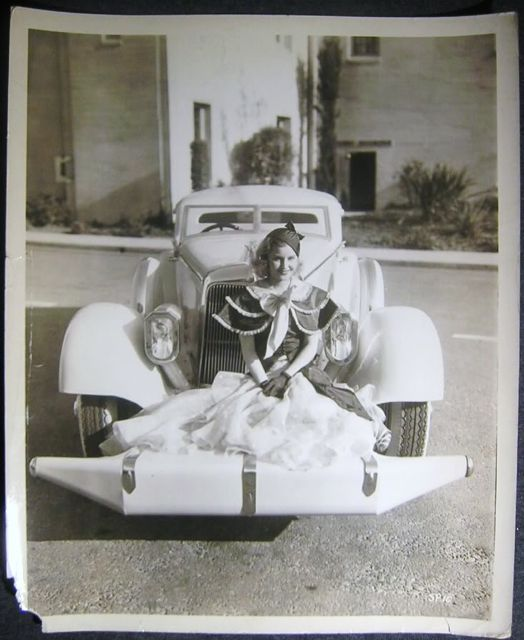 Lillian Harvey poses with an unidentified automobile that has, what must be, the weirdest front bumper we have ever seen. To the person who identifies this car and the year of the photo, we'll send you the gift of a fashion forward Seraphic Secret baseball cap.