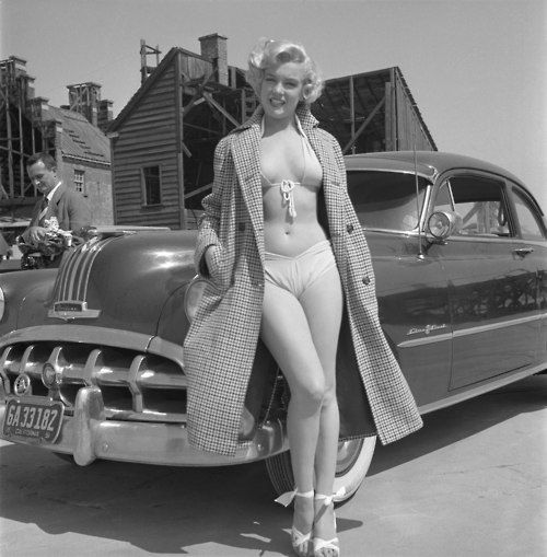 A girl, a bathing suit, and a hunk of Detroit steel. This is classic Americana: MM with a 1952 Pontiac.