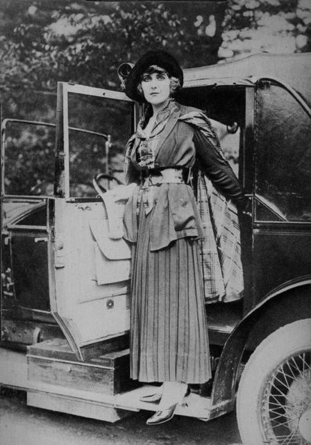 Pearl White, the hugely popular star of cliff-hanger serials, poses with her, no doubt, chauffeur-driven limousine, 1918.