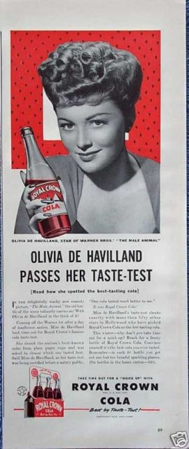 Olivia De Havilland forRoyal Crown Cola. De Havilland projected an aristocratic screen presence, which seems at odds with this rather banal ad.