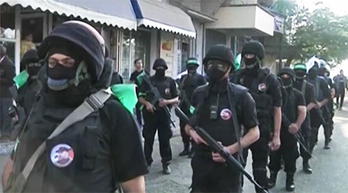 "Hamas ""civil servants"" in the streets of Gaza."