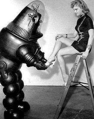 Almost 50 percent of women surveyed said they had judged someone based on their shoes. Half of that 50 percent said it was not a good impression! Anne Francis and Robby the Robot in Forbidden Planet.