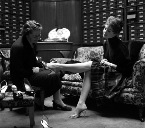 One in 2 women will lie about the purchase price to our significant other.  Brigitte Bardot trying on shoes at Rayne's the Queen's shoemakers, London, 1955.