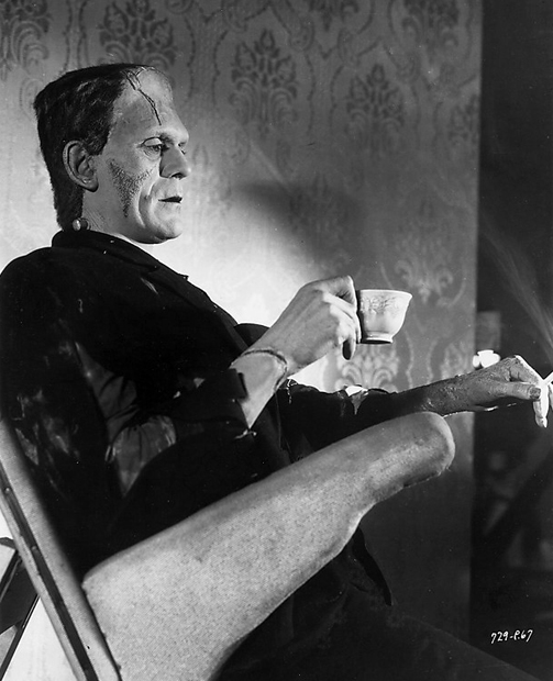 Even monsters have to lean. Boris Karloff sips tea on the set of Bride of Frankenstein.