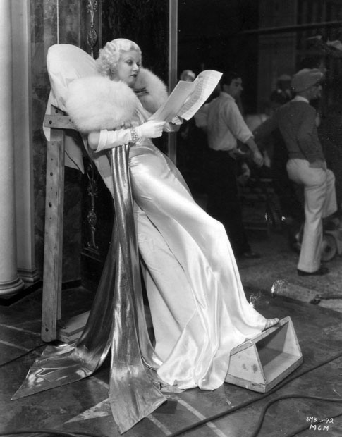 Jean Harlow relaxes on the set of Dinner at Eight. 1933 Costumes by Adrian, b. Adrian Adolph Greenburg.