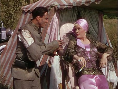 """In a scene for """"Singin' in the Rain ('52) struggling actor Don Lockwood (Gene Kelly) gets the brush-off from silent star diva Lina Lamont (Jean Hagen) as she rests on her leaning board."""