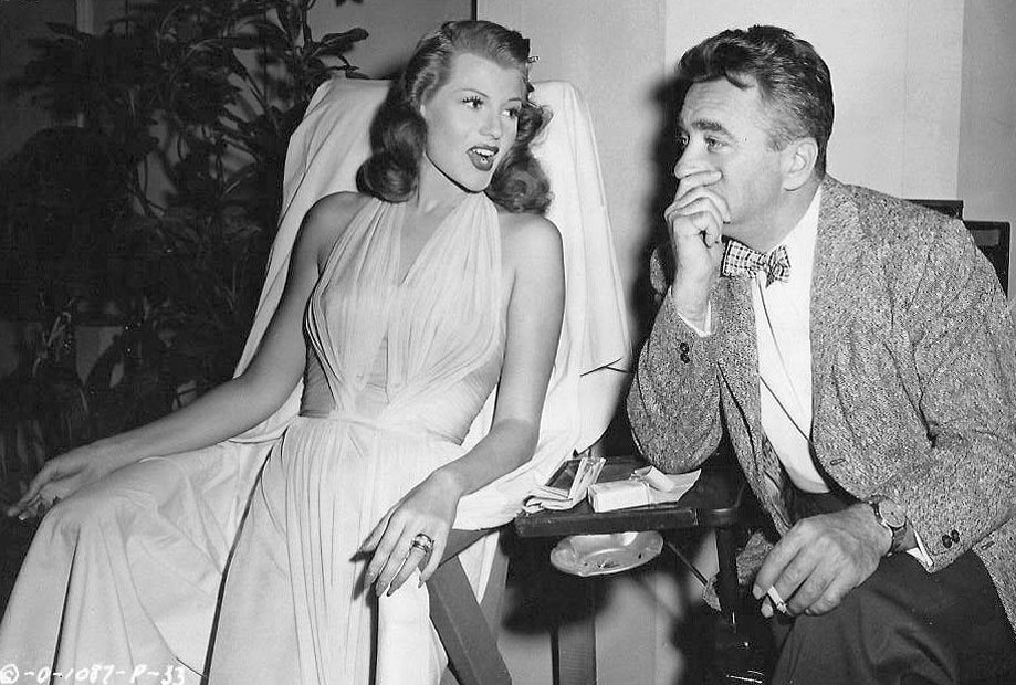 Rita Hayworth and director Charles Vidor on the set of Gilda.