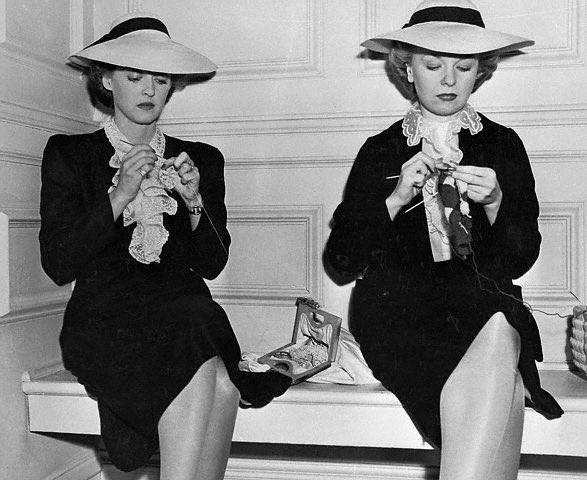"Bette Davis and her stand-in, Sally Sage, knit while in production of ""Now Voyager"", 1942."