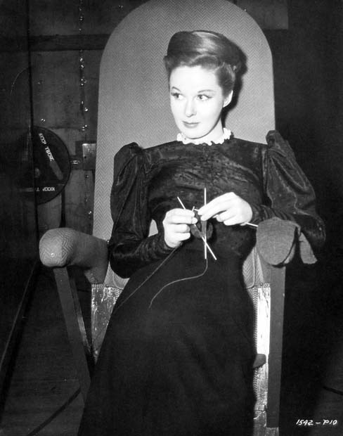 "Susan Hayward leans and knits between takes of ""The Lost Moment"" ('47)."