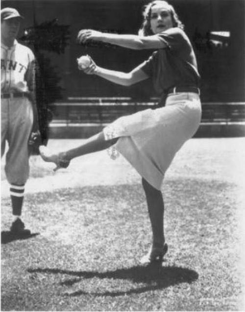 Carole Lombard winds up for a fastball. Nothing like playing baseball in high heels.