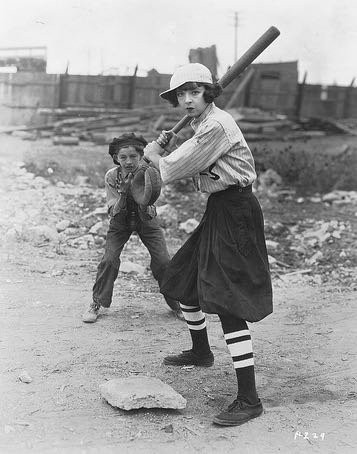 """Silent star Colleen Moore looks like a cute slugger in """"Painted People"""", 1924."""