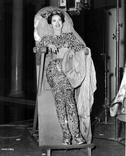 "Merle Oberon in a rather constricting and unflattering costume for ""Night in Paradise"" ('46)."