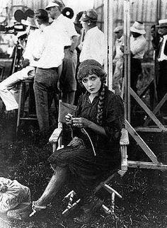 Mary Pickford knits while on location, 1920s.