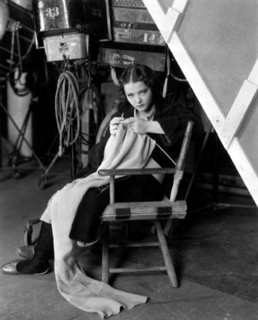 It looks like Sylvia Sidney is working on a blanket or a shawl.