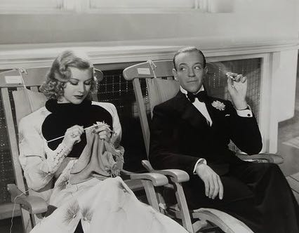 "Ginger Roger's character Linda Keene, knits as Fred Astaire looks on in 'Shall We Dance,"" 1937."