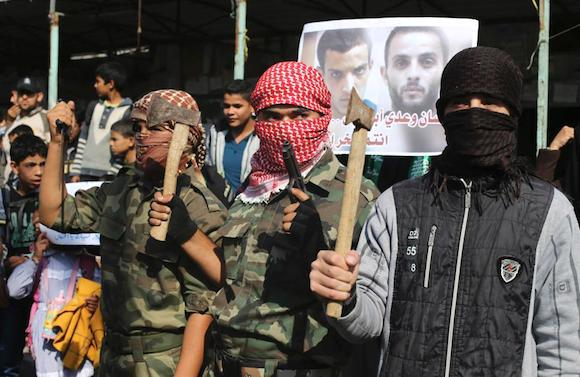 IslamoNazis line the streets of Gaza proudly brandishing axes.