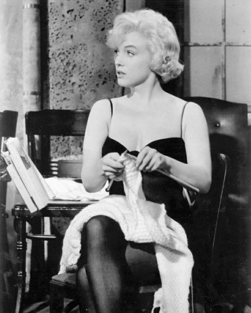 "Marilyn Monroe's character knits to pass the time in her last uncompleted movie, ""Let's Make Love,"" 1960."