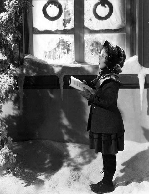 Shirley Temple (1928 - 2014) gets into the Christmas spirit.