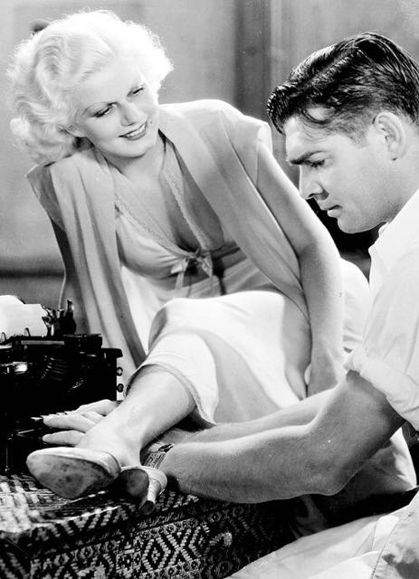 "Jean Harlow diverts Clark Gable from his work. ""Red Dust,"" 1933."