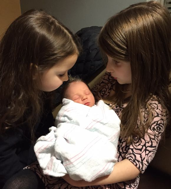 Lielle (l.) and Maayan (r.) get to know their new sister, Livia Yarden.