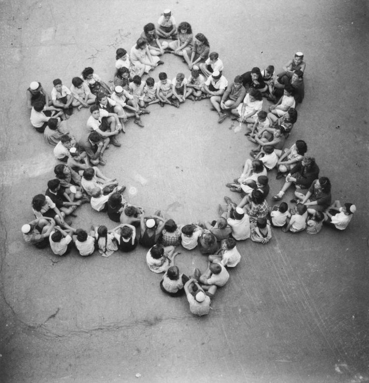 Child survivors of Buchenwald form a Magen David, 1946.
