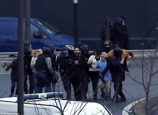 Photo shows kosher store hostages being freed by police.