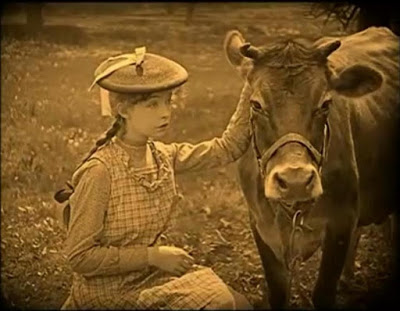 "Lillian Gish with bovine companion in DW Griffith's ""True Heart Susie"" (1919). The cow is a major plot point tin this film."