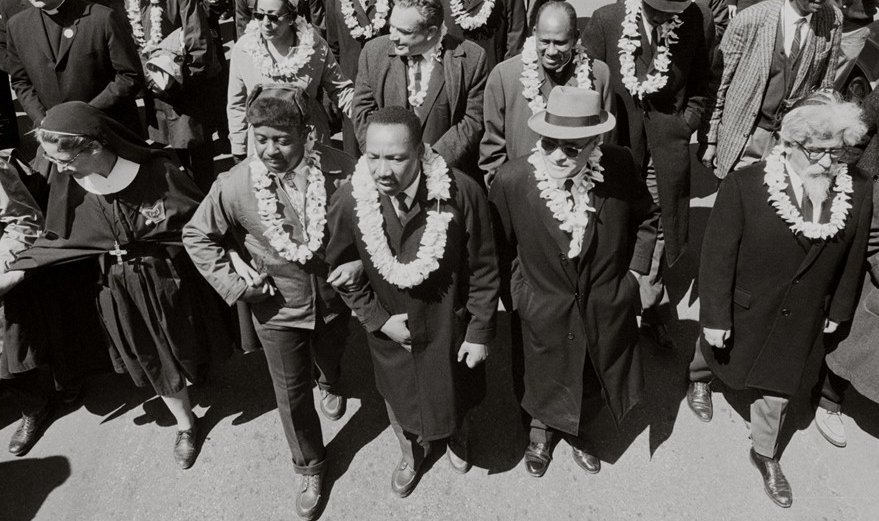 Rabbi Abraham Heschel, at right, with Rev. King, on the march from Selma, 1965.