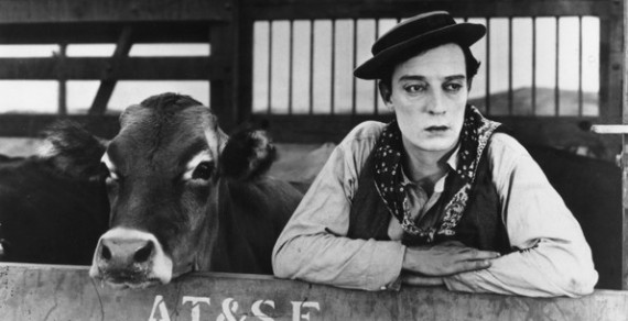 Buster Keaton with a cow. Not sure which film this is from, possibly Go West, but for some odd reason we have been coming across scores of pictures of Hollywood stars and cow.